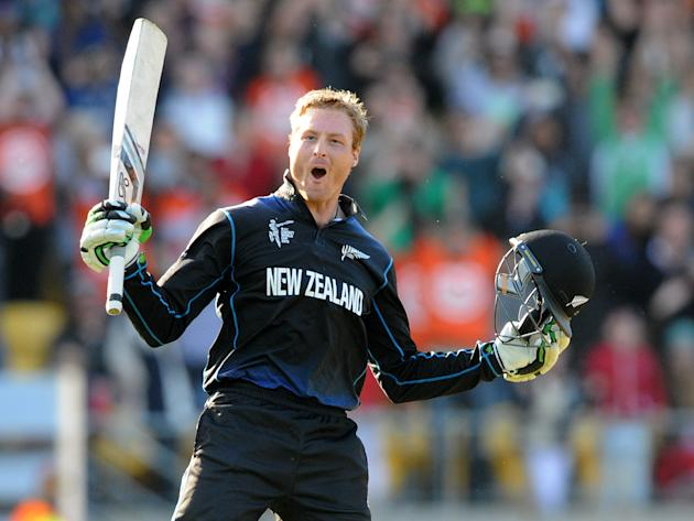 New Zealand's Martin Guptill celebrates after scoring a double century while batting against the West Indies during their Cricket World Cup quarterfinal match in Wellington, New Zealand, Saturda