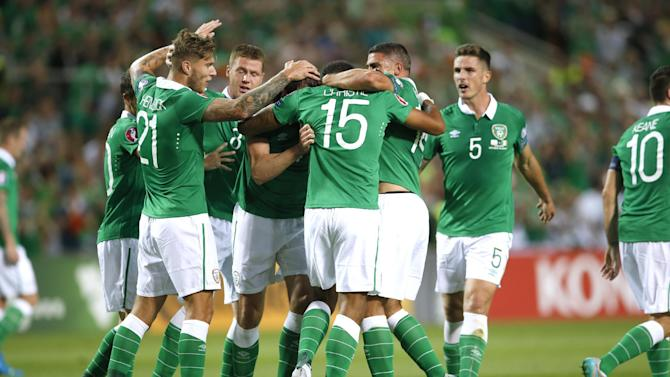 Cyrus Christie celebrates with team mates after scoring the first goal for Republic of Ireland