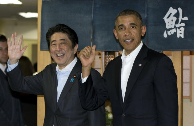 President Barack Obama and Japanese Prime Minister Shinzo Abe depart Sukiyabashi Jiro sushi restaurant in Tokyo, Wednesday, April 23, 2014. Opening a four-country swing through the Asia-Pacific region