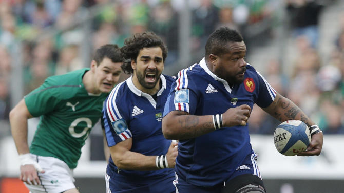 France's Mathieu Bastareaud, right, and Yoann Huget run during the Six Nations Rugby Union match between France and Ireland at the Stade de France stadium, in Saint Denis, outside Paris, Saturday March 15, 2014. (AP Photo/Christophe Ena)