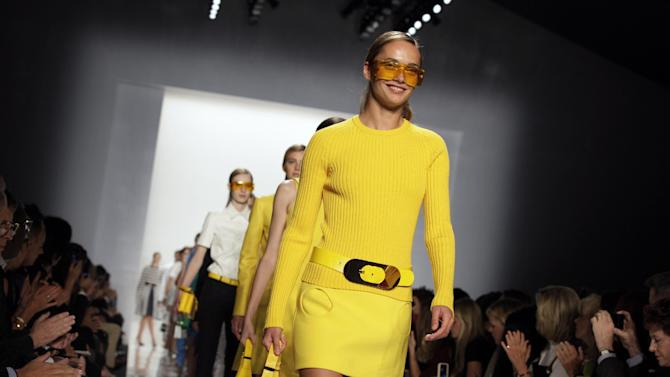 Models walk in the finale of the Michael Kors Spring 2013 collection during Fashion Week in New York,  Wednesday, Sept. 12, 2012. (AP Photo/Richard Drew)