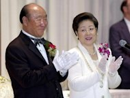 Sun Myung Moon (L) and his wife Hak Ja Han bless newlyweds during a mass wedding in New York in 2001. Moon, the self-styled messiah from South Korea who founded the controversial Unification Church, died Monday at the age of 92