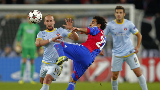 FC Basel's Salah challenges Steaua Bucharest's Latovlevici during Champions League soccer match in Basel