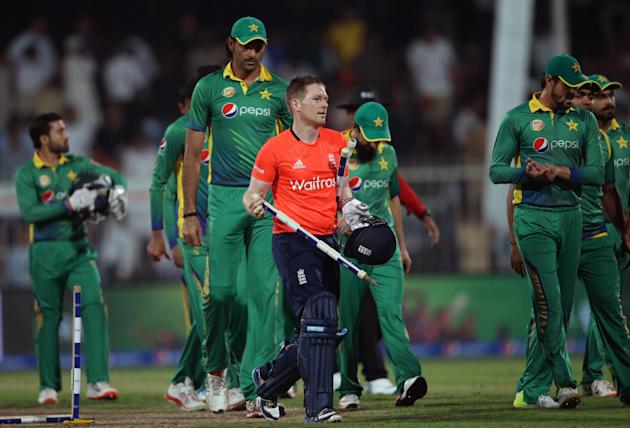 England's batsman Eoin Morgan takes the wickets after the third T20 cricket match between Pakistan and England at the Sharjah Cricket Stadium in Sharjah, United Arab Emirates, Monday, Nov. 30, 201