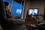 People watch on TV the televised national debate between Francois Hollande and Nicolas Sarkozy at their home in Meyzieu, near Lyon, central eastern France. Sarkozy launched fierce assaults on his rival Hollande in their pre-poll debate but failed to land a decisive blow