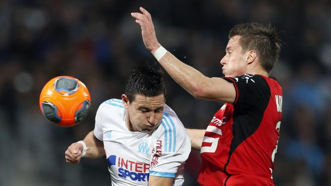 Olympique Marseille's Thauvin jumps to head the ball against Konradsen during their French Ligue 1 soccer match at the Velodrome stadium in Marseille