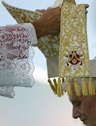 A mitre is placed on Pope Benedict XVI during an open-air mass in Beirut. The pontiff prayed on Sunday that Middle East leaders work towards peace and reconciliation, stressing again the central theme of his visit to Lebanon, whose neighbour Syria is engulfed in civil war
