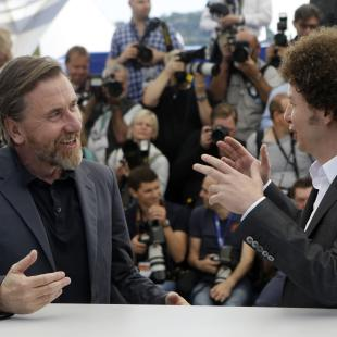 Actor Tim Roth, left, and director Michel Franco pose for photographers during a photo call for the film Chronic, at the 68th international film festival, Cannes, southern France, Friday, May 22, 2015. (AP Photo/Lionel Cironneau)