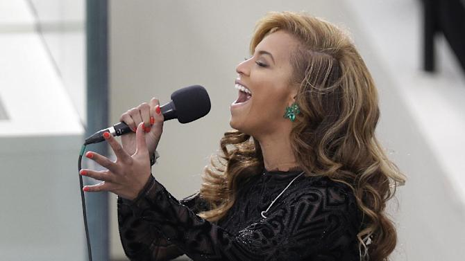 Beyonce sings the National Anthem at the ceremonial swearing-in for President Barack Obama at the U.S. Capitol during the 57th Presidential Inauguration in Washington, Monday, Jan. 21, 2013. (AP Photo/Evan Vucci)