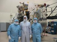 Well-dressed and entering Maven's haven, are, left to right: SPACE.com's Leonard David; Jeff Coyne, Maven assembly, test and launch operations (ATLO) manager at Lockheed Martin; and Gary Napier, communications specialist for Lockheed Martin Spa