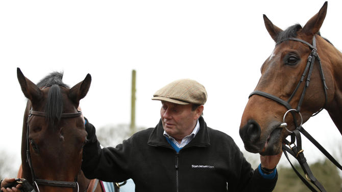 Trainer Nicky Henderson with Top Notch (L) and Whisper (R) during the stable visit