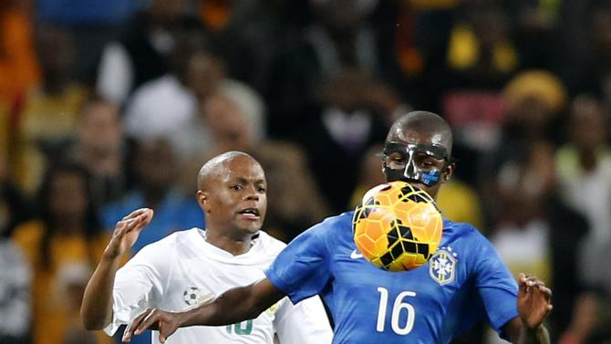 Brazil's Ramires is challenged by South Africa's Thulani Serero during their international friendly soccer match at the First National Bank (FNB) Stadium, also known as Soccer City, in Johannesburg