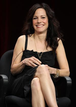 """Actress Mary-Louise Parker, from the television show """"Weeds"""", smiles during the CW Showtime TCA Panels, Monday, July 30, 2012, in Beverly Hills, Calif. Showtime announced on Monday, July 29, 2012 the series finale date for """"Weeds"""" that will air on September 16, 2012. (Photo by Matt Sayles/Invision/AP)"""