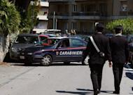 Italian police carry out investigations at the site where Roberto Adinolfi was shot in Genoa. A gunman on a motorbike has shot and wounded the head of Italian nuclear energy company Ansaldo Nucleare, with investigators quoted in media reports saying anarchists could be responsible