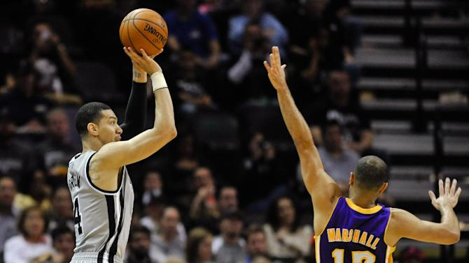 San Antonio Spurs guard Danny Green shoots a 3-pointer against Los Angeles Lakers guard Kendall Marshall in the first half of an NBA basketball game Friday, March 14, 2014 in San Antonio