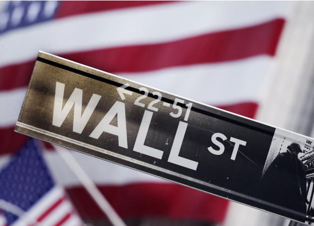FILE - This Aug. 9, 2011 file photo shows a Wall Street street sign near the New York Stock Exchange, in New York. Stocks are opening mostly higher Tuesday, April 28, 2015, as the health care sector r
