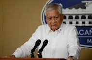 "Department of Foreign AffairsSecretary Albert Del Rosario answers questions during a press briefing at the Malacanang palace in Manila on April 26, 2013. The Philippines on Friday accused Beijing of engaging in the ""de facto occupation"" of a disputed shoal in the South China Sea, following a face-off that began last year"