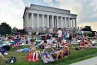 People gather at the Lincoln Memorial to watch fireworks in celebration of Fourth of July in Washington, DC, on July 4, 2012. Independence Day, commonly known as the Fourth of July, is a federal holiday in US commemorating the adoption of the Declaration of Independence on July 4, 1776, declaring independence from Great Britain