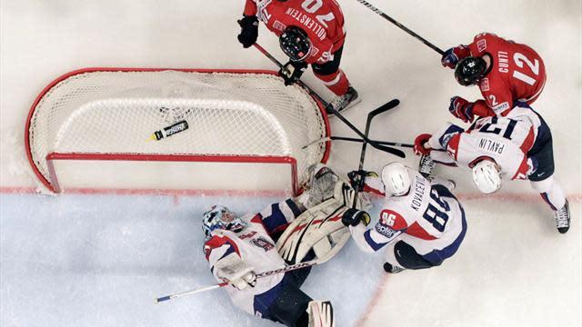 Ice Hockey - Swiss crush Slovenia, US ease past Finland