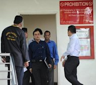 Officials leave the mortuary room after identifying the body of an Indian gang-rape victim from New Delhi who died overnight, at Singapore General Hospital, on December 29, 2012. The victim, 23, died overnight after suffering severe organ failure, the hospital treating her said, in a case that sparked widespread street protests over violence against women