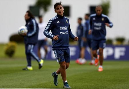 Argentina's Dybala jogs during a training session ahead of their 2018 World Cup qualifying soccer match against Brazil in Buenos Aires