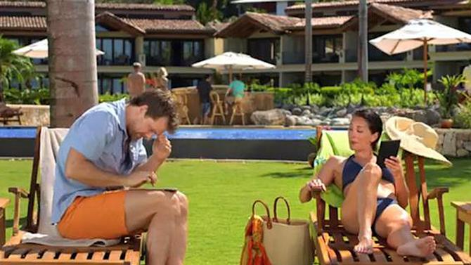 This image from video shows an image from a Kindle Paperwhite commercial featuring a young woman lounging next to a  young man, waiting for their husbands, shown in the background at the bar. Welcome to the latest in gay imagery in mainstream advertising, where LGBT people have been waiting for a larger helping of fairness and accuracy, on screen and in print. Traditionally lagging behind TV and film content in terms of LGBT inclusion, advertisers in this country are suffering considerably less blowback for the effort. (AP Photo/Amazon)