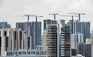 "Photo from August 31, 2010 shows a new highrise apartment block being built in Singapore. The International Monetary Fund said Monday it is ""carefully"" monitoring massive capital flows into Asia and urged the region's policymakers to guard against risks of overheating"