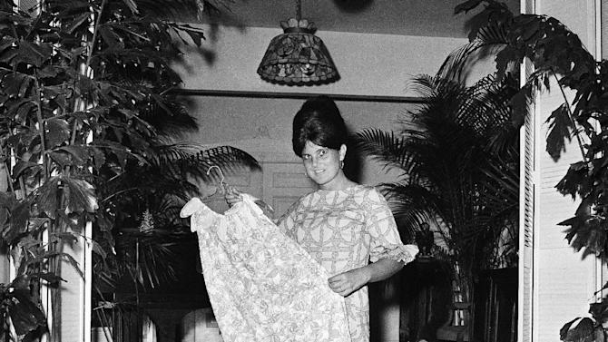 FILE - In this March 16, 1965 file photo, Palm Beach the fashion designer Lilly Pulitzer, wears her own design and creation of the Lilly shift, in Palm Beach, Fla. Pulitzer, known for her tropical print dresses, died in Florida at 81 on Sunday, April, 7, 2013. (AP Photo/Robert H. Houston, File)