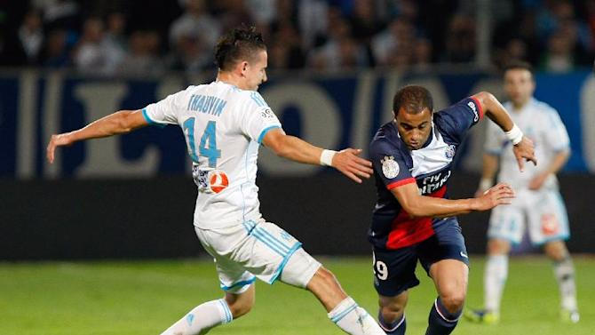 Paris Saint Germain's Brazilian midfielder Lucas, right, challenges for the ball with Marseille's French midfielder Florian Thauvin, during their League One soccer match, at the Velodrome Stadium, in Marseille, southern France, Sunday, Oct. 6, 2013