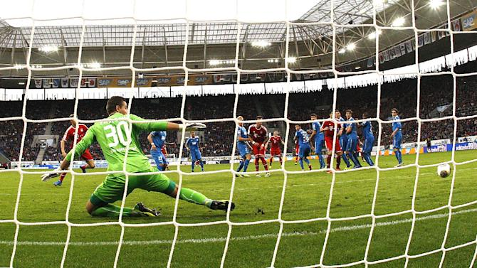 Bayern's Mario Mandzukic of Croatia, center, scores his side's equalizing goal during a German first division Bundesliga soccer match between TSG 1899 Hoffenheim and Bayern Munich in Sinsheim, Germany, Saturday, Nov.2, 2013