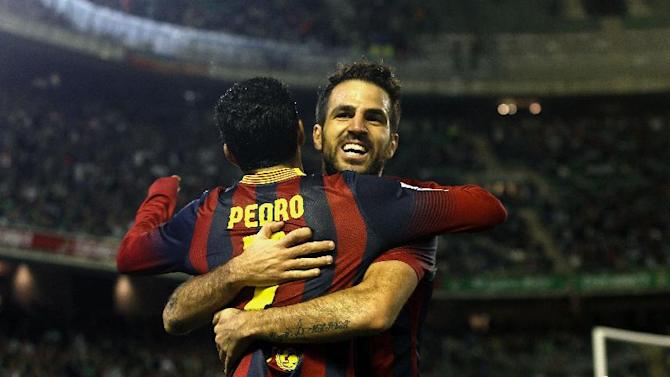 Barcelona's Pedro Rodriguez, front, celebrates with teammate Francesc Fabregas after scoring against Betis during their La Liga soccer match at the Benito Villamarin stadium, in Seville, Spain, Sunday, Nov. 10, 2013