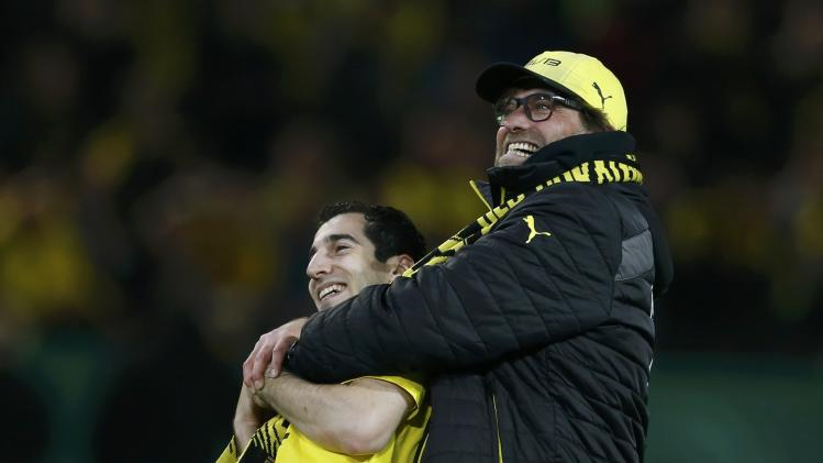 Borussia Dortmund's Mkhitaryan celebrates with coach Klopp after German soccer cup semi-final match against WfL Wolfsburg in Dortmund