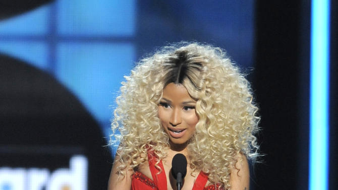 Nicki Minaj accepts the award for top rap artist at the Billboard Music Awards at the MGM Grand Garden Arena on Sunday, May 19, 2013 in Las Vegas. (Photo by Chris Pizzello/Invision/AP)