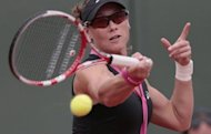 Australia's Samantha Stosur hits a return to Russia's Nadia Petrova during their women's singles match of the French Open tennis tournament at the Roland Garros stadium in Paris. Stosur won 6-3, 6-3