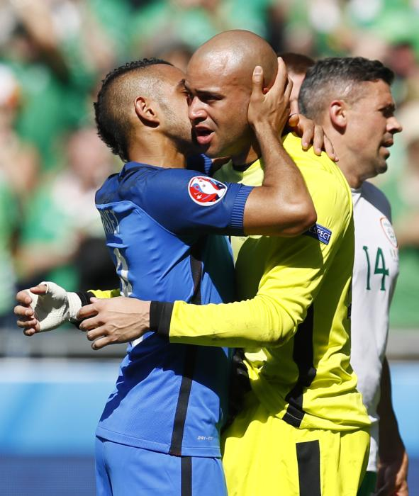 Republic of Ireland's Darren Randolph and France's Dimitri Payet hug after the game