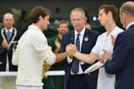 Roger Federer (L) shakes hands with Andy Murray after his men's singles final victory on Day 13 of the 2012 Wimbledon Championships at the All England Tennis Club in southwest London. Federer won the match 4-6, 7-5, 6-3, 6-4