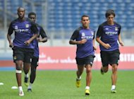Manchester City's Yaya Toure (L) warms up with his teammates during a training session in Malaysia in July. The team will face European champions Chelsea in the traditional curtain raiser to the English season at Villa Park this weekend