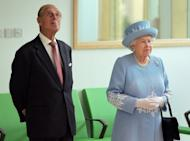 Britain's Queen Elizabeth II and Prince Philip listen arrive at the South West Acute Hospital in Enniskillen, Northern Ireland, on June 26. The monarch is poised to make a historic gesture in Northern Ireland's peace process when she shakes the hand of former IRA commander Martin McGuinness