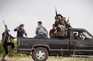 "Members of the Free Syrian Army's ""Commandos Brigade"" on patrol near Qusayr, on May 10. The UN has condemned mass slaughter near the central town of Houla on Friday and Saturday in which 108 people died, including 49 children and 34 women"