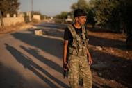A Syrian rebel mans a checkpoint at the entrance to the town of Azaz, north of Aleppo, on August 11. The battle for Syria is raging on the ground but also on social media, where people on both sides of the conflict are hacking, posting and spamming in a frenzied propaganda war