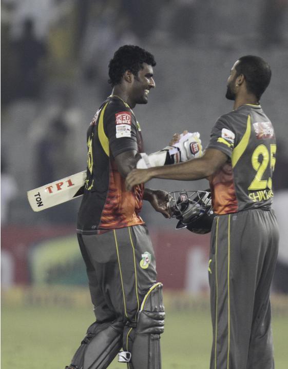 SRH batsman Thisara Perera and KV Sharma celebrates win during the CLT20 match between Trinidad & Tobago and Sunrisers Hyderabad at Mohali, Chandigarh on Sept. 24, 2013. (Photo: IANS)