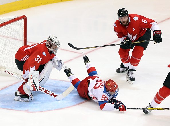 TORONTO, ON - SEPTEMBER 24: Evgeny Kuznetsov #92 of Team Russia is knocked down in front of Carey Price #31 of and Shea Weber #6 of Team Canada at the semifinal game during the World Cup of Hockey 2016 at Air Canada Centre on September 24, 2016 in Toronto, Canada. (Photo by Dave Sandford/World Cup of Hockey via Getty Images)
