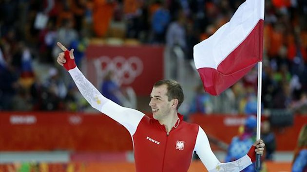 Zbigniew Brodka of Poland celebrates winning the men's 1,500 metres (Reuters)