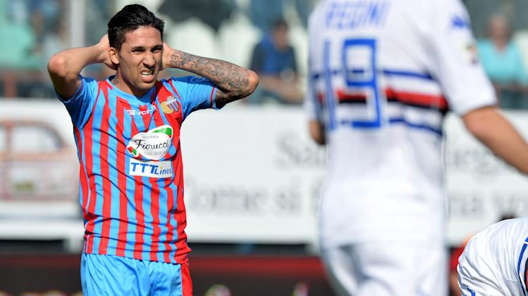 Catania midfielder Lucas Castro, left, of Argentina, reacts after missing a scoring chance during the Serie A soccer match between Catania and Sampdoria at the Angelo Massimino stadium in Catania, Italy, Saturday, April 19, 2014
