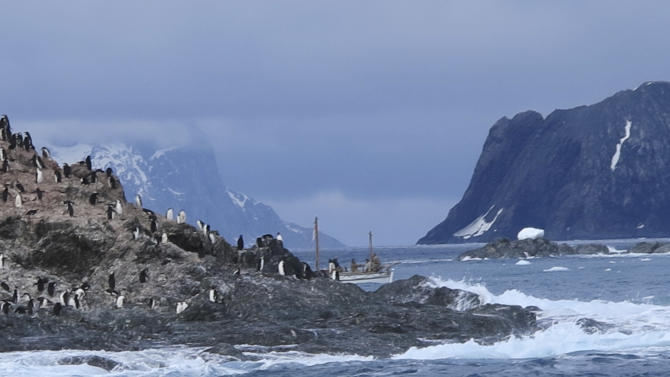 In this Feb. 7, 2013 photo released by Shackleton Epic, the expedition crew on their boat Alexander Shackleton pass Point Wild on Elephant Island in the Southern Ocean. A modern-day team of six led by Tim Jarvis and Barry Gray used similar equipment and clothes to a re-enacted a 1916 expedition led by Ernest Shackleton to save his crew after their ship got stuck in Antarctica's icy waters. In honor of the epic journey the team sailed 800 nautical miles on the Southern Ocean in a small lifeboat and then climbed over crevasse-filled mountains in South Georgia to complete the historic journey. (AP Photo/Shackleton Epic, Jo Stewart)