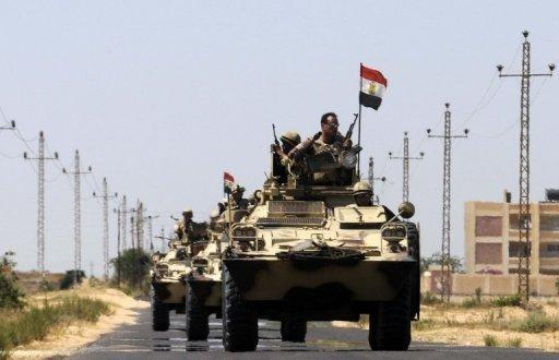 Egyptian soldiers deployed close to the Rafah border crossing with the Gaza Strip, pictured on May 21, 2013