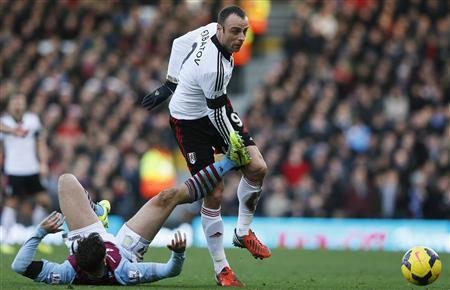 Fulham's Berbatov is challenged by Aston Villa's Herd during their English Premier League soccer match at Craven Cottage in London