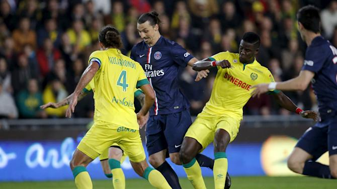 Paris St Germain's Ibrahimovic challenges FC Nantes' Vizcarrondo and Djilobodji during their French Ligue 1 soccer match at the Beaujoire stadium in Nantes