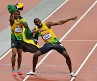 Jamaica's Usain Bolt (R) and Jamaica's Yohan Blake celebrate after winning the men's 4x100m relay final at the athletics event of the London 2012 Olympic Games