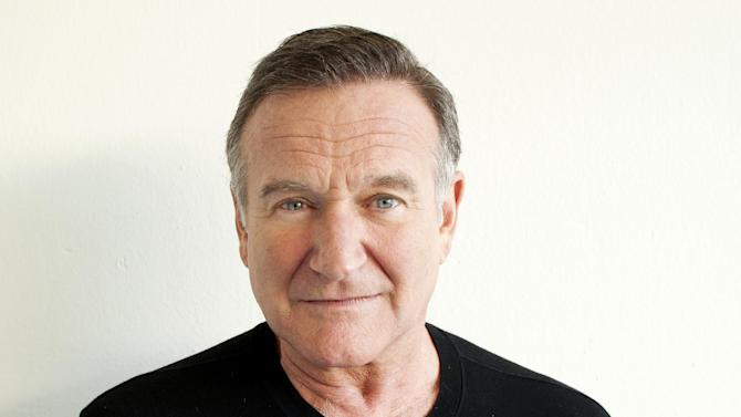 "FILE - In this Nov. 5, 2011 file photo, actor Robin Williams poses for a portrait during the ""Happy Feet"" Press Junket in Beverly Hills, Calif. Authorities say an autopsy on Williams found no alcohol or illegal drugs in his system when he committed suicide at his Northern California home in August 2014. The Marin County sheriff's office released the autopsy results Friday, Nov. 7, 2014. (Photo by Dan Steinberg/Invision/AP)"